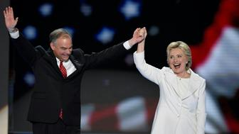 Balloons come down on Democratic presidential nominee Hillary Clinton and running mate Tim Kaine at the end of the fourth and final night of the Democratic National Convention at Wells Fargo Center on July 28, 2016 in Philadelphia, Pennsylvania.   / AFP / SAUL LOEB        (Photo credit should read SAUL LOEB/AFP/Getty Images)