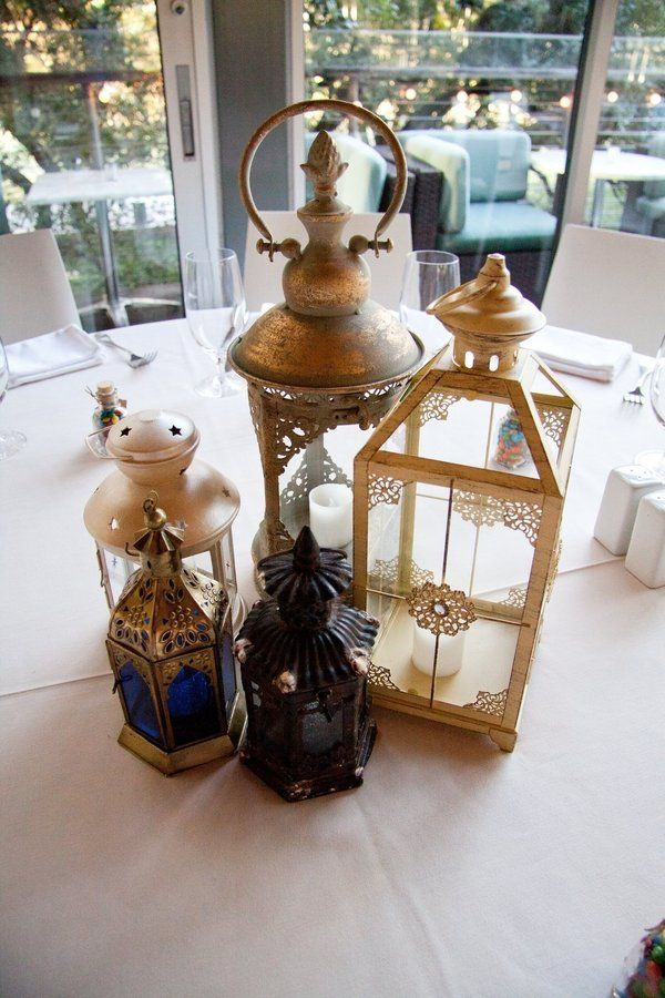 """Tangled"" table with lantern centerpieces."