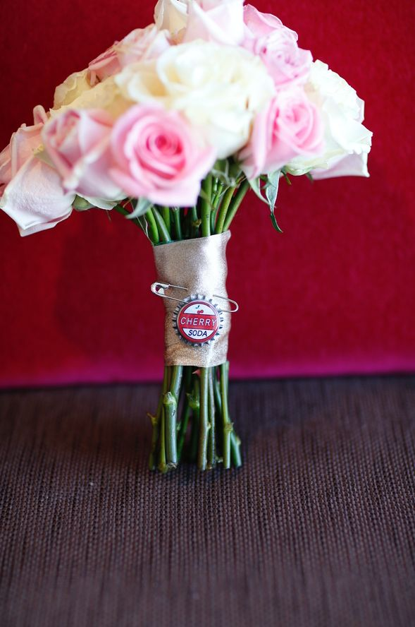 "The ""Up""-inspired bouquet featured a cherry soda bottle cap."