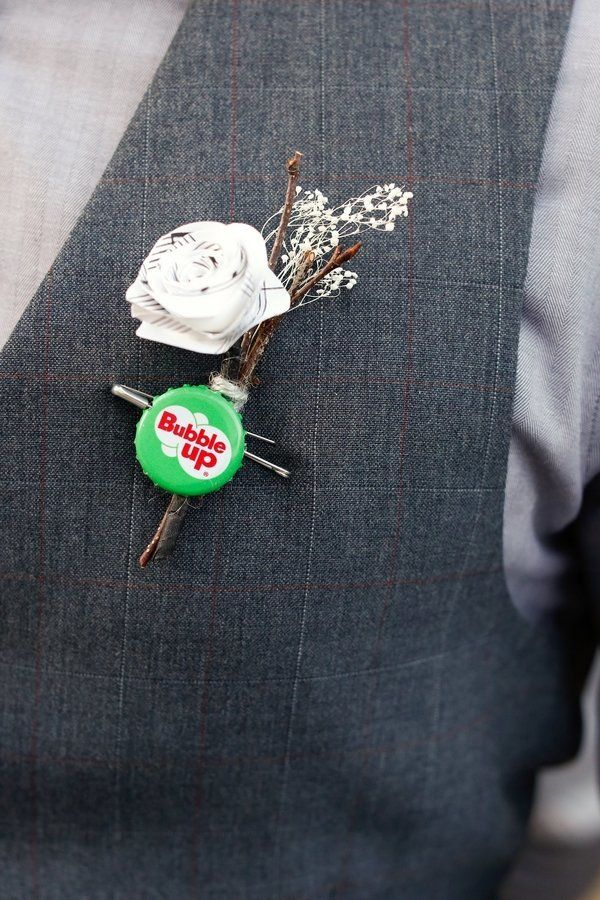 The groom and groomsmen rocked bottle cap boutonnières.
