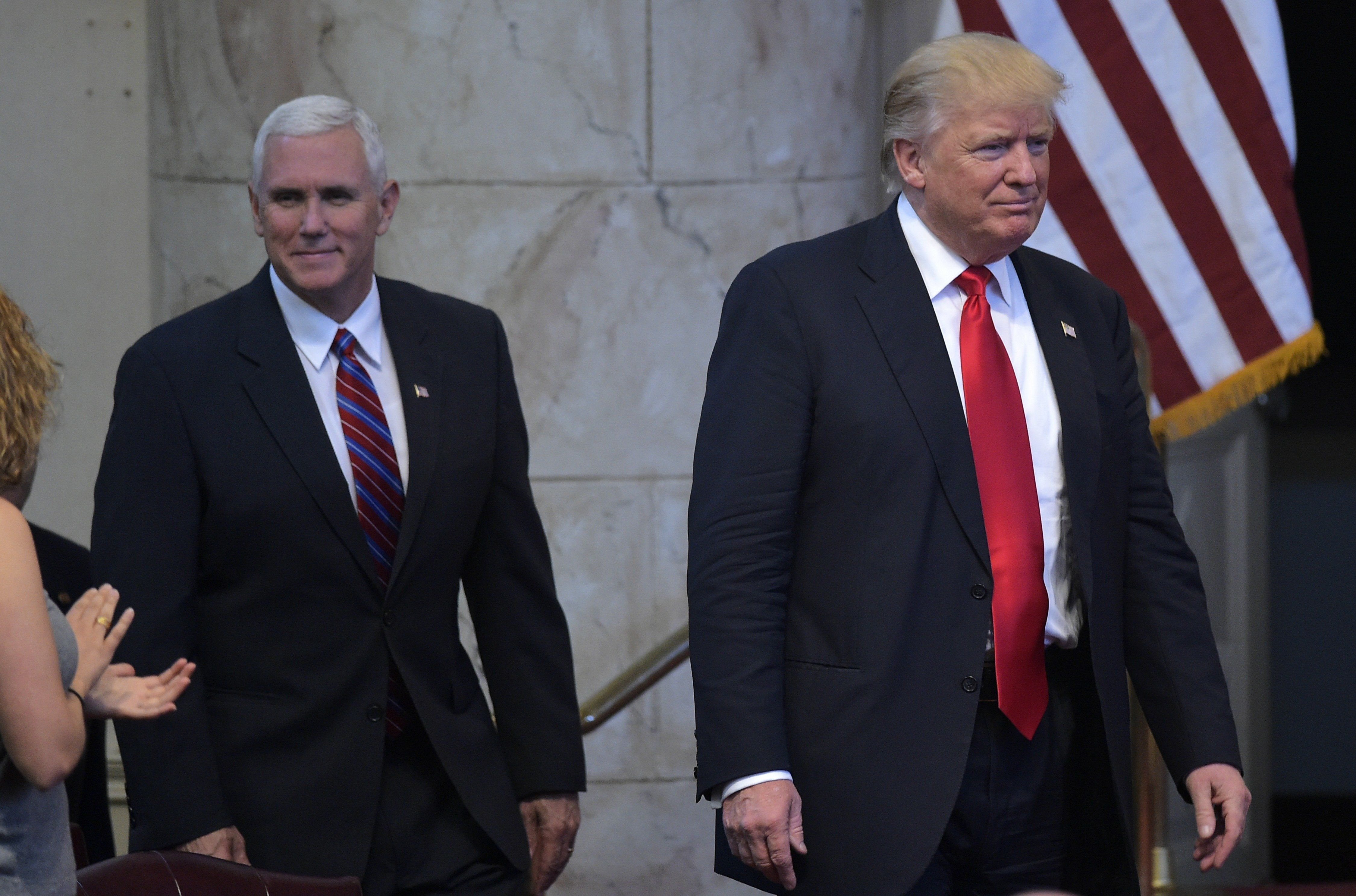 Republican presidential nominee Donald Trump (R) and running mate Mike Pence arrive for the Midwest Vision and Values Pastors and Leadership Conference at the New Spirit Revival Center in Cleveland Heights, Ohio on September 21, 2016. / AFP / MANDEL NGAN        (Photo credit should read MANDEL NGAN/AFP/Getty Images)