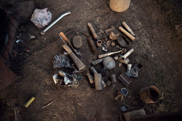 Aluminum objects, including bomb parts, waiting tobe melted into raw pieces of jewelry ordered...