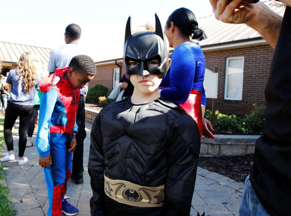 Landen Gilbert dressed as Batman stands in line to enter Oakdale Baptist church for the funeral of his cousin, 6-year-old Jac
