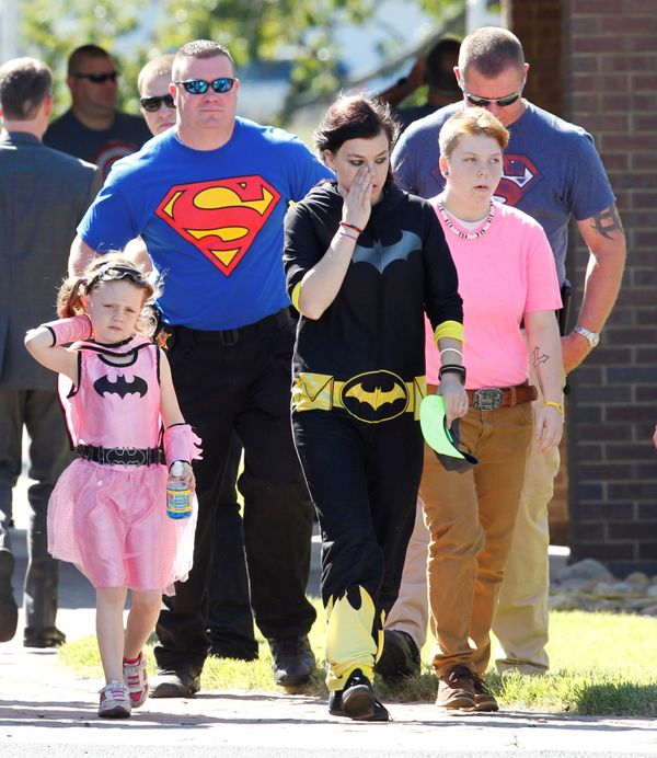 Mourners dressed as super heroes leave Oakdale Baptist church after the funeral of 6-year-old Jacob Hall.