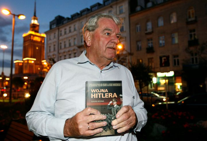 """The real David Irving, holding the Polish-language version of his book """"Hitler's War."""" Irving is brilliantly portrayed by act"""