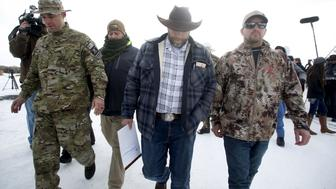 "Ammon Bundy departs after addressing the media at the Malheur National Wildlife Refuge near Burns, Oregon, January 4, 2016. The leaders of a group of self-styled militiamen who took over a U.S. wildlife refuge headquarters over the weekend said on Monday they had acted to protest the federal government's role in governing wild lands. Bundy, a leader of the group, told reporters outside the occupied facility on Monday that his group had named itself ""Citizens for Constitutional Freedom"" and was trying to restore individual rights. Bundy and law enforcement officials declined to say how many people were occupying the refuge headquarters. REUTERS/Jim Urquhart"