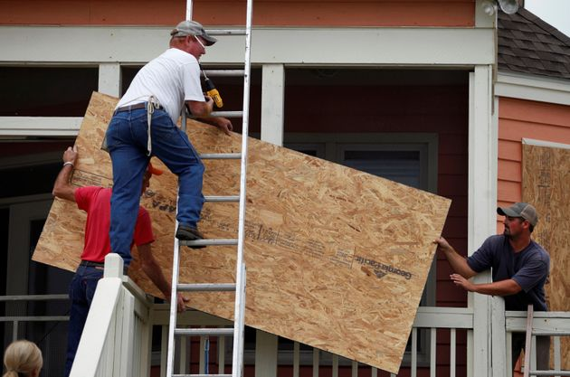 A man in Lake City, South Carolina boards up a house ahead of Hurricane Matthew's
