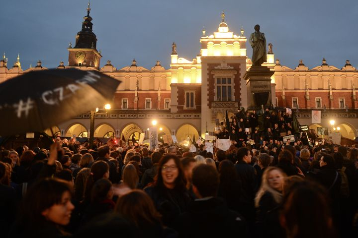 Thousands of people protest against the proposed abortion laws on Debnicki Square, in Krakow, Poland, on Monday.