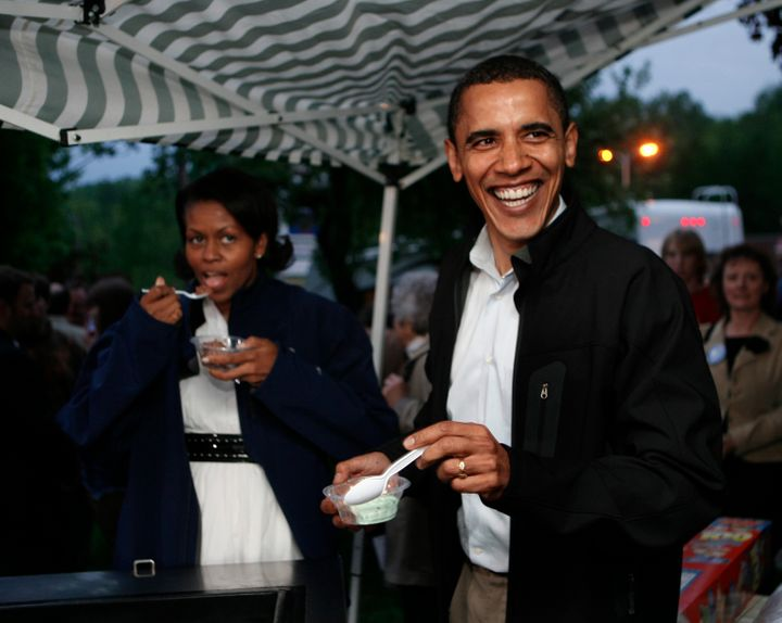 Obama eating ice cream and so happy about it.