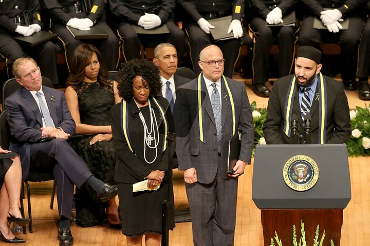 President of the United States Barack Obama looks on as prayers are given by Rev. Dr. Sheron Patterson, Imam Omar Suleiman an