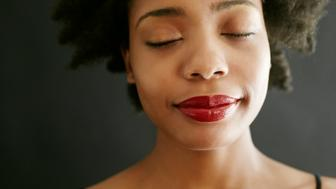 Close up of black woman with eyes closed