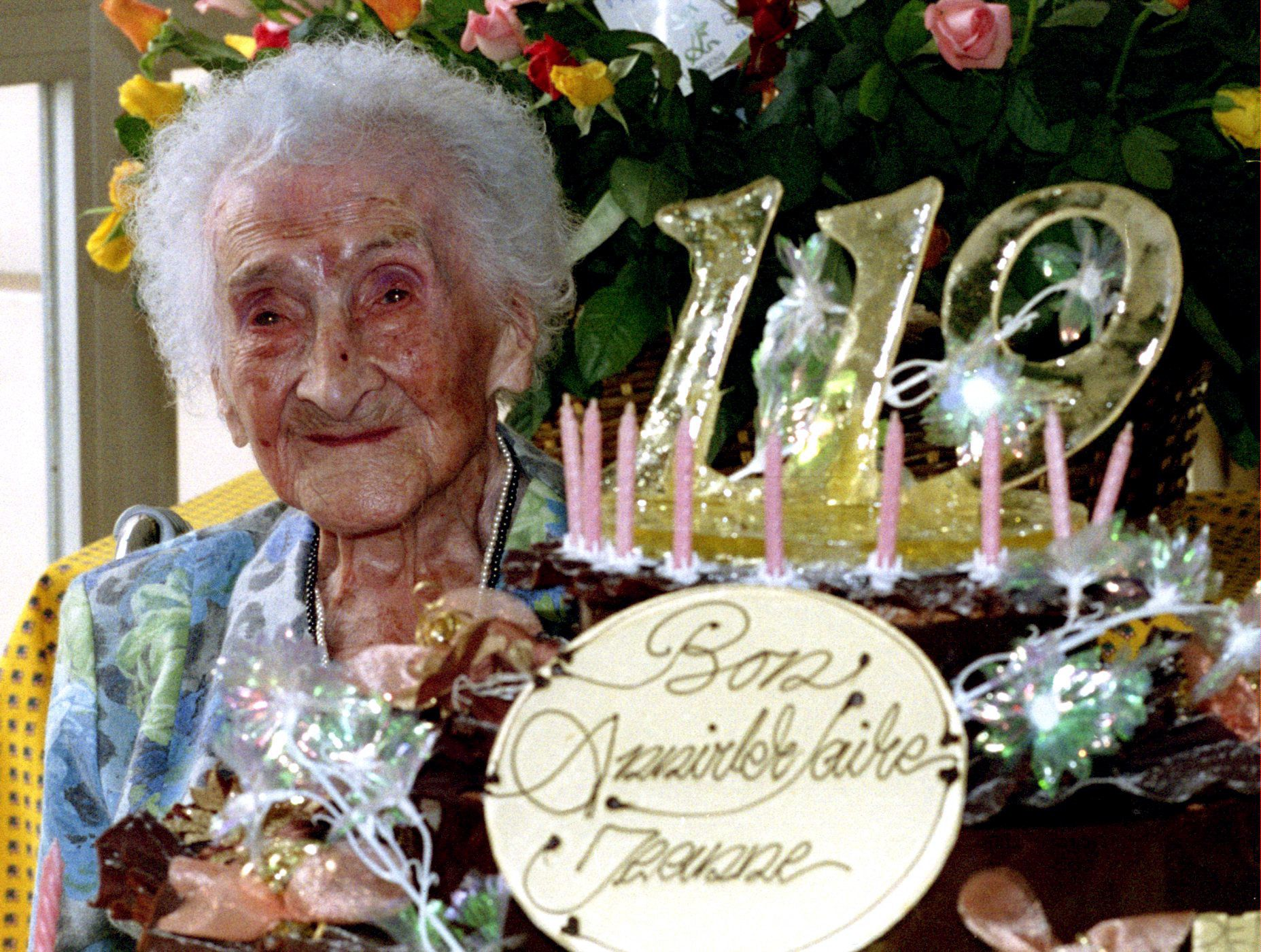 The world's oldest woman, Jeanne Calment, celebrates her 119th birthday in Arles, February 21st. Calment, who lives in a retirement home in the sourthern French city, celebrated with a large cake