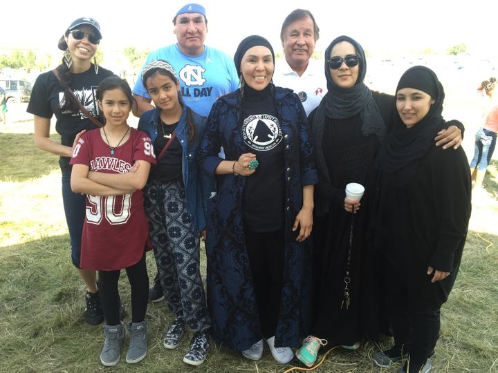 Leslie Henderson Oajaca (front row, second from right) stands with a group of indigenous Muslims who visited Sacred Stone Cam