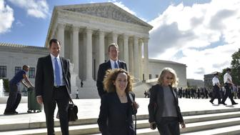 Alexandra Shapiro (front, L) and John Cline (rear, R) lawyers for Bassam Salman are seen outside of the US Supreme Court after attending a hearing in his insider trading case on October 5, 2016 in Washington, DC. / AFP / MANDEL NGAN        (Photo credit should read MANDEL NGAN/AFP/Getty Images)