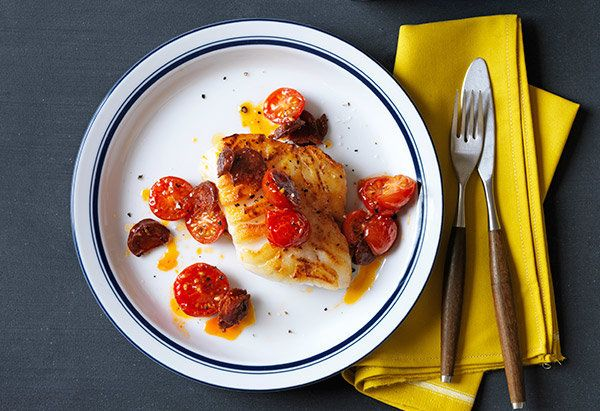 Cod fillets topped with a from-scratch tomato sauce bolstered with smoky Spanish chorizo sounds like the type of dish that co