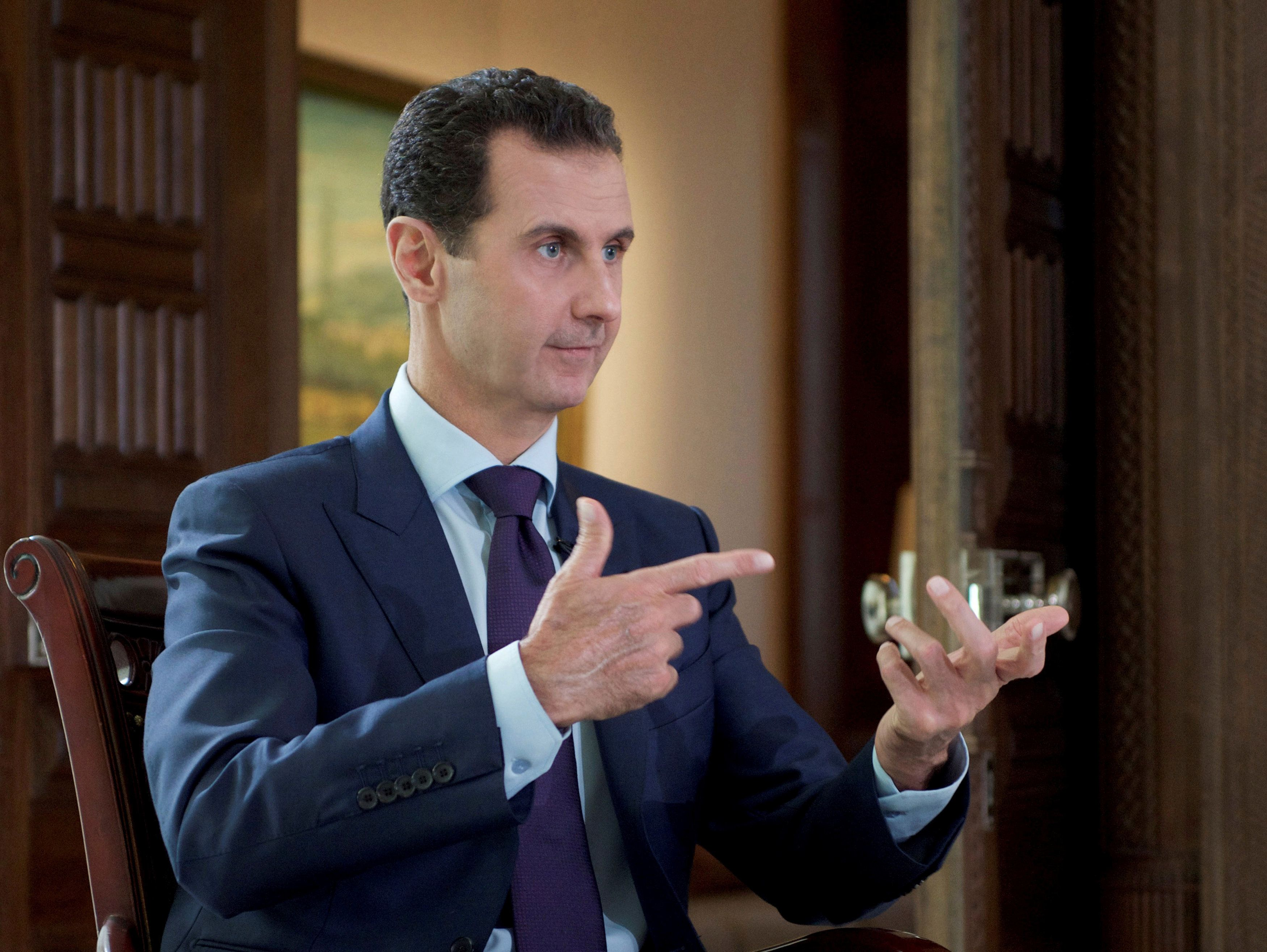 Syria's President Bashar al-Assad speaks during an interview with Denmark's TV 2, in this handout picture provided by SANA on October 6, 2016. SANA/Handout via REUTERS ATTENTION EDITORS - THIS PICTURE WAS PROVIDED BY A THIRD PARTY. REUTERS IS UNABLE TO INDEPENDENTLY VERIFY THE AUTHENTICITY, CONTENT, LOCATION OR DATE OF THIS IMAGE. FOR EDITORIAL USE ONLY.
