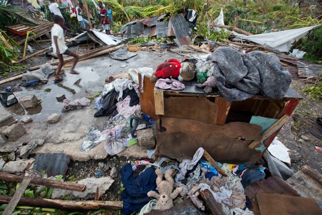 Personal items lie scattered outside homes destroyed by Hurricane Matthew in Les Cayes, Haiti, Thursday,...
