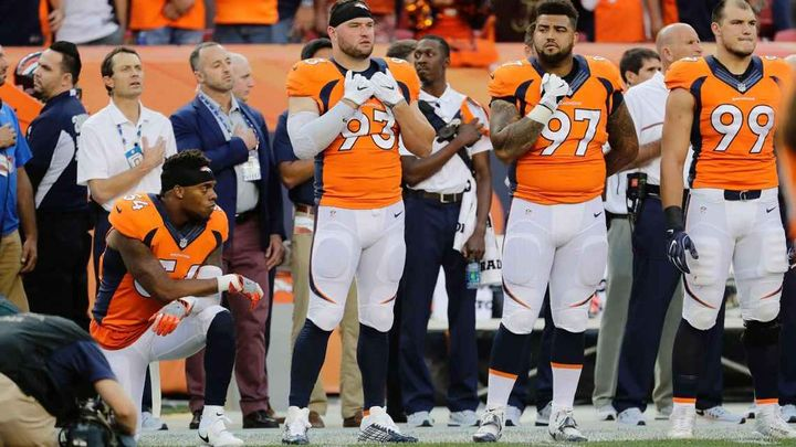 Denver Broncos linebacker kneels during National Anthem