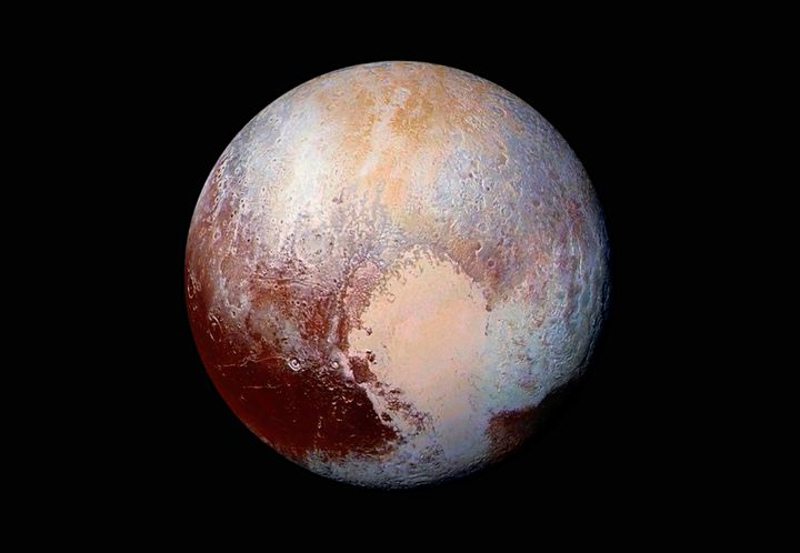 This NASA photo of Pluto was made from four images by New Horizons' Long Range Reconnaissance Imager (LORRI), combined with c