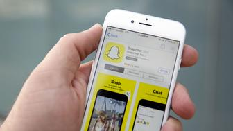 The Snapchat Inc. application is displayed in the App Store on an Apple Inc. iPhone 6 in this arranged photograph taken in the Venice Beach neighborhood of Los Angeles, California, U.S., on Wednesday, March 2, 2016. People using the application for disappearing photos view 8 billion videos a day, the same number that Facebook reports, the CEO Evan Spiegel told an audience at the Morgan Stanley technology conference Photographer: Patrick T. Fallon/Bloomberg via Getty Images