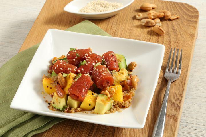 Fresh & Co's Poke Side Salad with cucumber, mango, avocado, red onion, quinoa, cashews and sesame oil