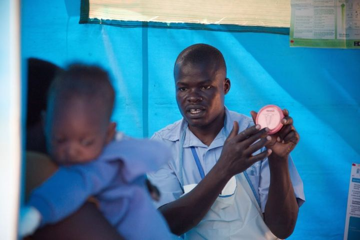 A Marie Stopes counsellor shows a young mother a long-term contraceptive. To try to tackle Uganda's high rate of unsafe