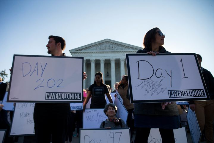 Demonstrators urgemembers of the Senate to hold a confirmation vote for Supreme Court nominee Merrick Garland on Oct. 4