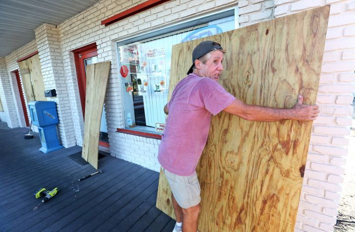 A man boards up a house in Cape Canaveral ahead of Matthew's anticipated arrival on Thursday evening.
