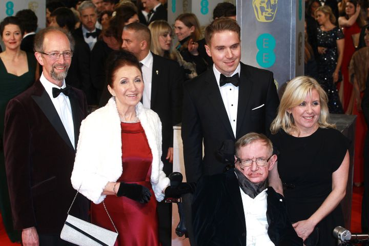 Stephen Hawking, Jane Wilde Hawking and family attend the British Academy Film Awards at The Royal Opera House on Feb. 8, 201