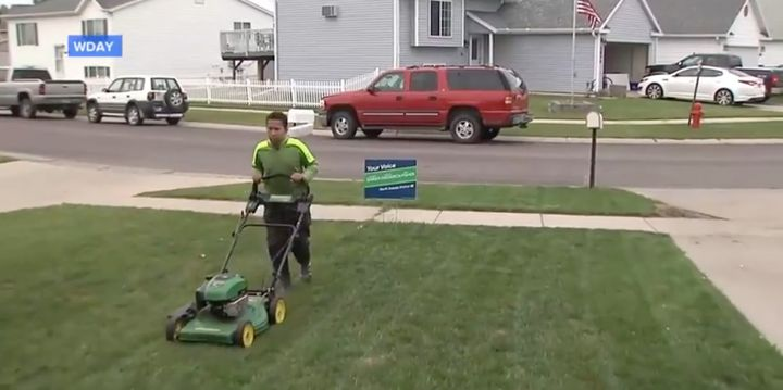Brandon mowing lawns.