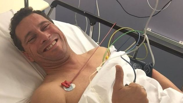 Woolfe gives the thumbs up from his hospital