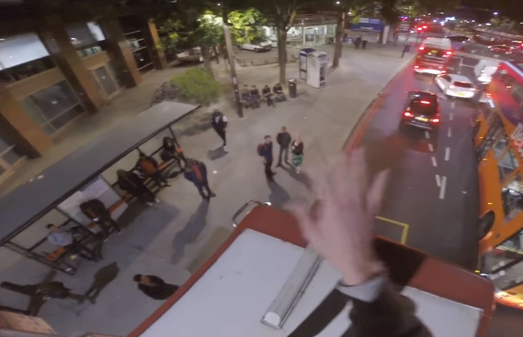 A daredevil has posted a video on YouTube showing him riding a double decker bus in