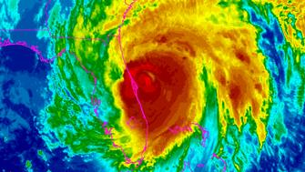 Hurricane Matthew is seen moving up the east coast of Florida in this infrared image from NOAA's GOES-East satellite taken at 07:45am ET (11:45 GMT) October 7, 2016.   NOAA/Handout via REUTERS  FOR EDITORIAL USE ONLY. NOT FOR SALE FOR MARKETING OR ADVERTISING CAMPAIGNS