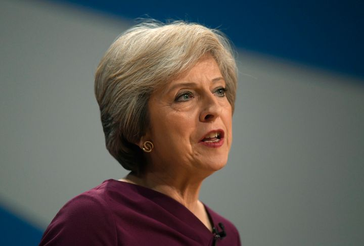 Britain's Prime Minister Theresa May gives her speech on the final day of the annual Conservative Party Conference in Birming