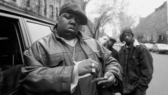 UNITED STATES - JANUARY 18:  Rapper Notorious B.I.G., aka Biggie Smalls, aka Chris Wallace rolls a cigar outside his mother's house in Brooklyn.  (Photo by Clarence Davis/NY Daily News Archive via Getty Images)
