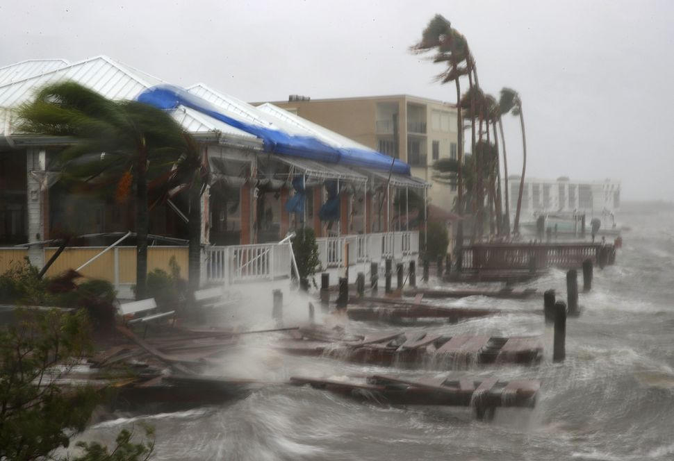Heavy waves caused by Hurricane Matthew pound the boat docks at the Sunset Bar and Grill on Cocoa Beach, Florida.