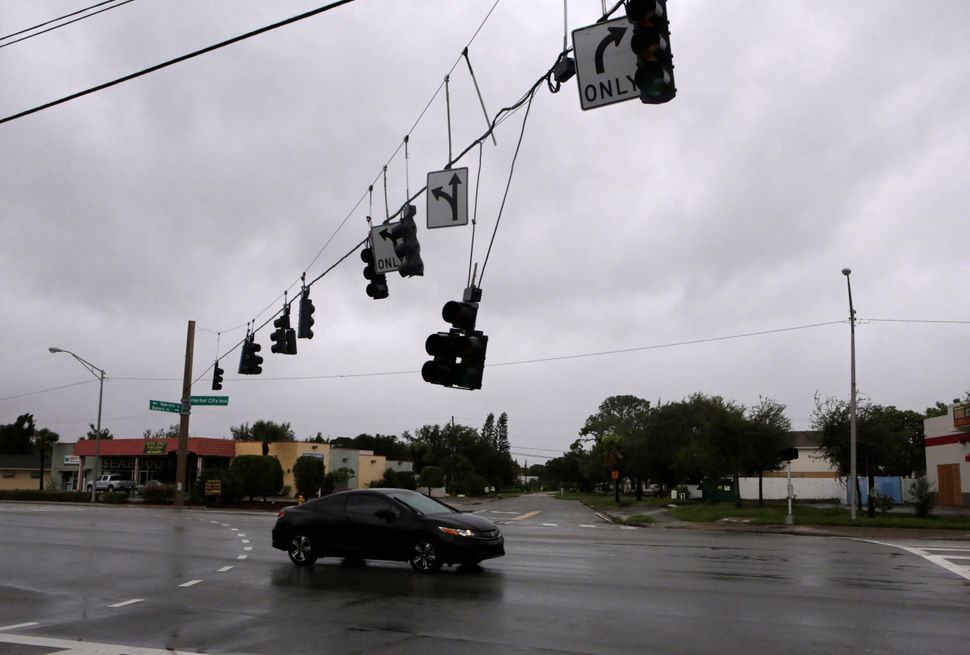 A traffic lamp damaged by wind is seen after Hurricane Matthew hits in Melbourne, Florida, on Friday.