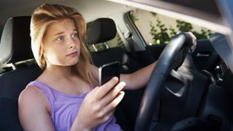 A teenage girl looking really nervous as she is sitting alone in the driver's seat of a carhttp://195.154.178.81/DATA/istock_collage/0/shoots/784352.jpg