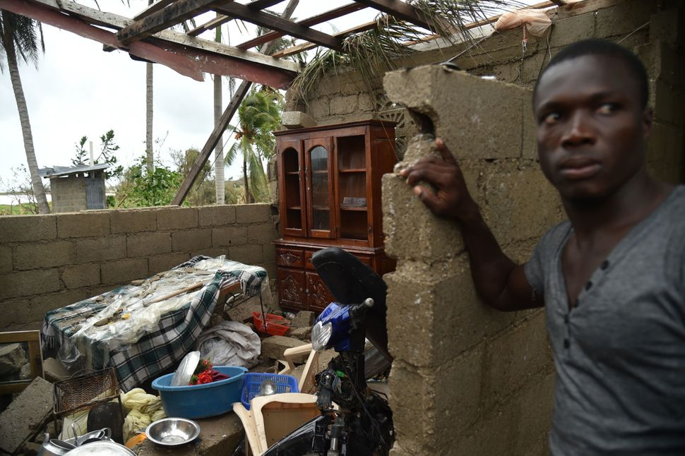 Stanley stands in his destroyed house after the passing of Hurricane Matthew, in Les Cayes, in Southwest Haiti, on October 6,