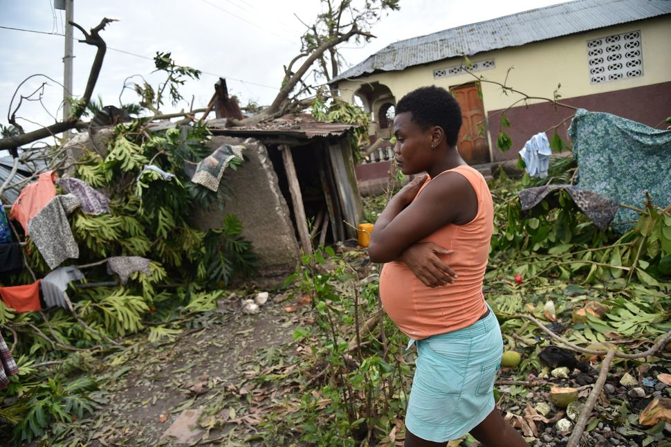 Stephanie, 26, walks in the yard of her destroyed home after Hurricane Matthew, in Croix Marche-a-Terre, in Southwest oh Hait