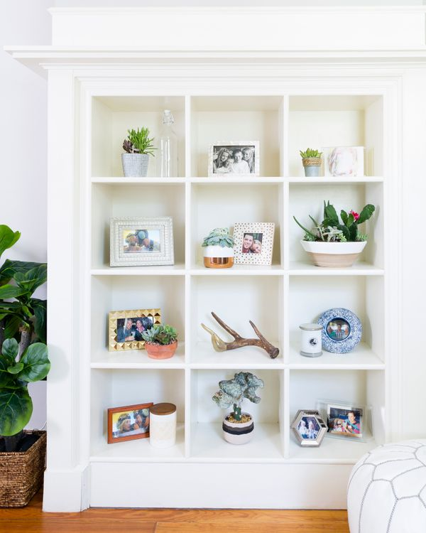 A bookcase displays keepsakes and photosin a picture-perfect, geometric space.