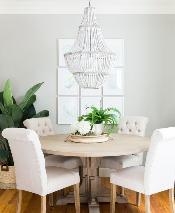 """The kitchen table is clean and airy, with a <a href=""""http://www.huffingtonpost.com/entry/anthropologie-home_us_57e571a8e4b0e8"""