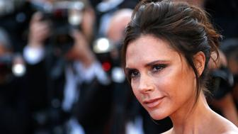 "Fashion designer, model and singer Victoria Beckham poses on the red carpet as she arrives for the opening ceremony and the screening of the film ""Cafe Society"" out of competition during the 69th Cannes Film Festival in Cannes, France, May 11, 2016.   REUTERS/Yves Herman"