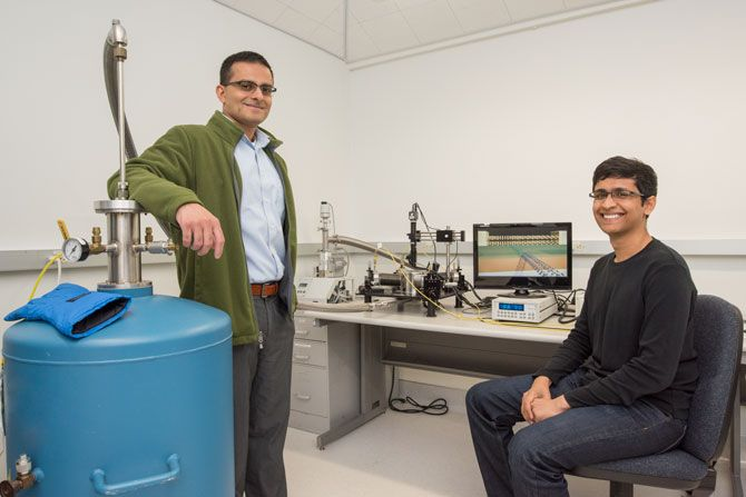 Berkeley Lab faculty scientist and UC Berkeley professor Ali Javey (left) and graduate student Sujay Desai created the smalle