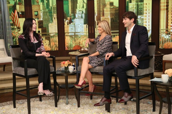 Kelly Ripa with co-hostAshton Kutcher and guest Laura Prepon on Oct. 7.