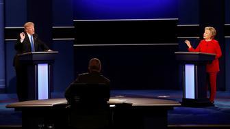 Republican U.S. presidential nominee Donald Trump and Democratic U.S. presidential nominee Hillary Clinton speak at their first presidential debate at Hofstra University in Hempstead, New York, U.S., September 26, 2016. Picture taken September 26, 2016. REUTERS/Mike Segar