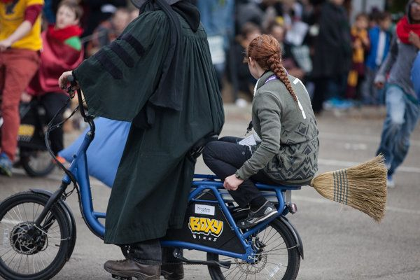 A quidditch match is played on motorized bikes.