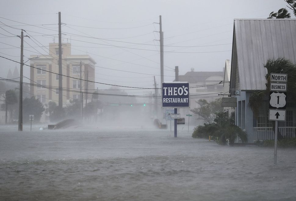 High winds stir up a flooded street as Hurricane Matthew passes through the area on Friday in St. Augustine, Florida.