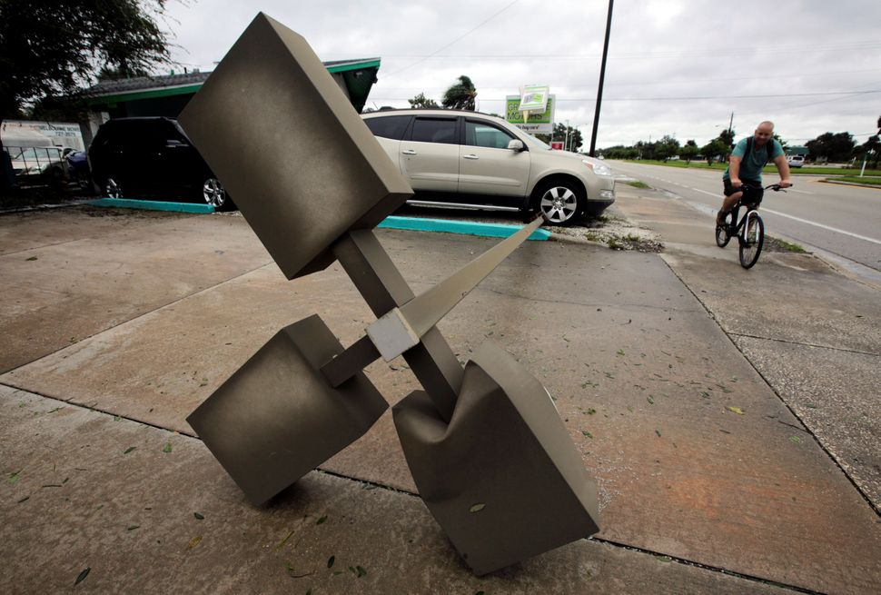 A lamp post is seen on a sidewalk after Hurricane Matthew hits in Melbourne, Florida, on Friday.