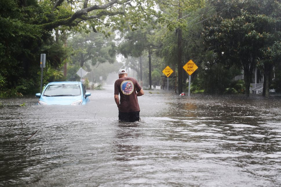 A man walks through a flooded street in St. Augustine, Florida.